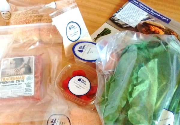 Picture of all the ingredients for the Pimento Cheeseburger with Collard Greens and Carrot slaw recipe from Blue Apron.