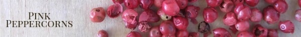 Pink peppercorns on a wood board