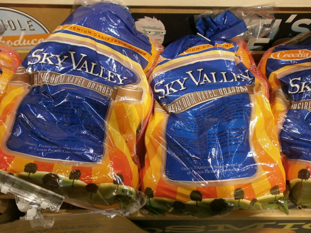 Bags of Sky Valley Heirloom Navels sitting on boxes at Whole Foods Market