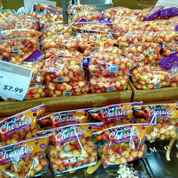 A display at Whole Foods Market of bags of Rainier cherries priced at $7.99 per pound.