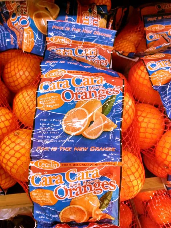 Bags of Ceclia brand Cara Cara oranges.