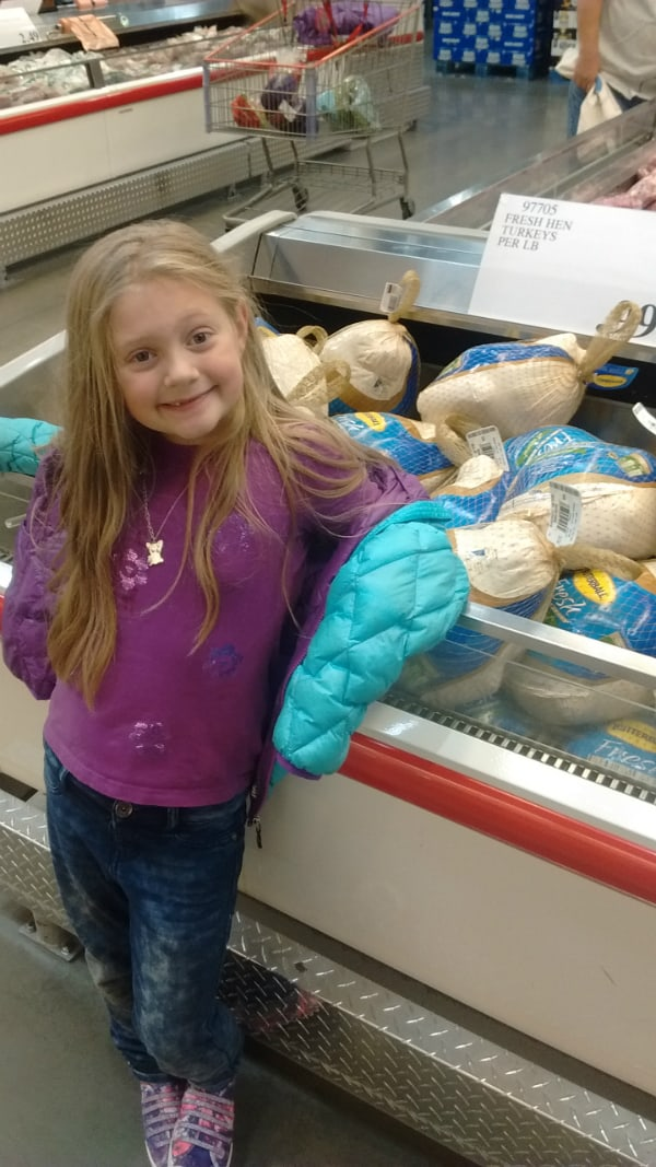 My daughter excited about the Butterball Fresh Turkeys at Costco