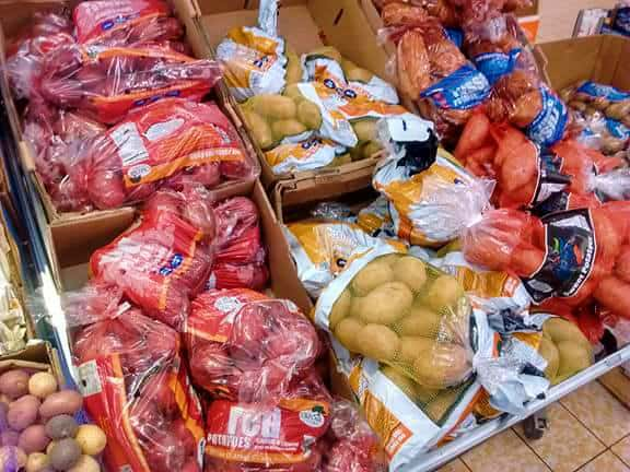A display of bagged potatoes from an ALDI store.