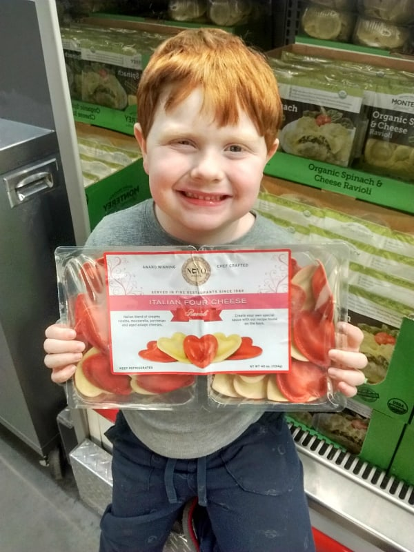 My son holding his favorite Heart Shaped, Italian Four Cheese filled Ravioli.