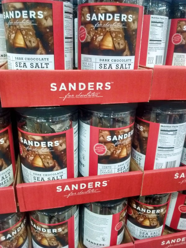 Sanders Dark Chocolate Seal Salt Caramels displayed in plastic containers