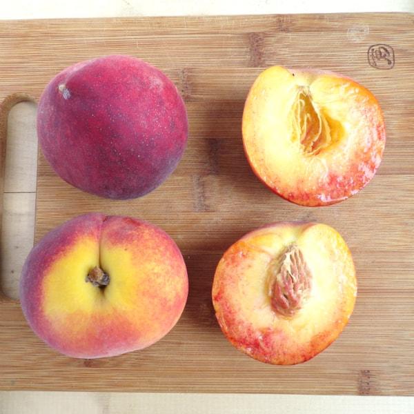4 Blaze Prince peaches sitting on a cutting board