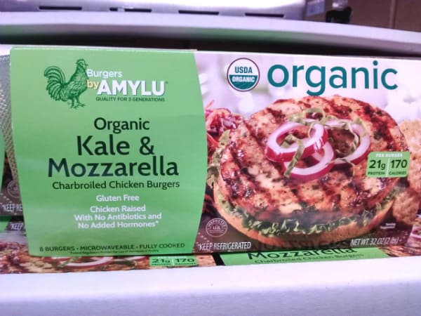 A box of Amylu Organic Kale & Mozzarella Charbroiled Chicken Burgers on dsiaply