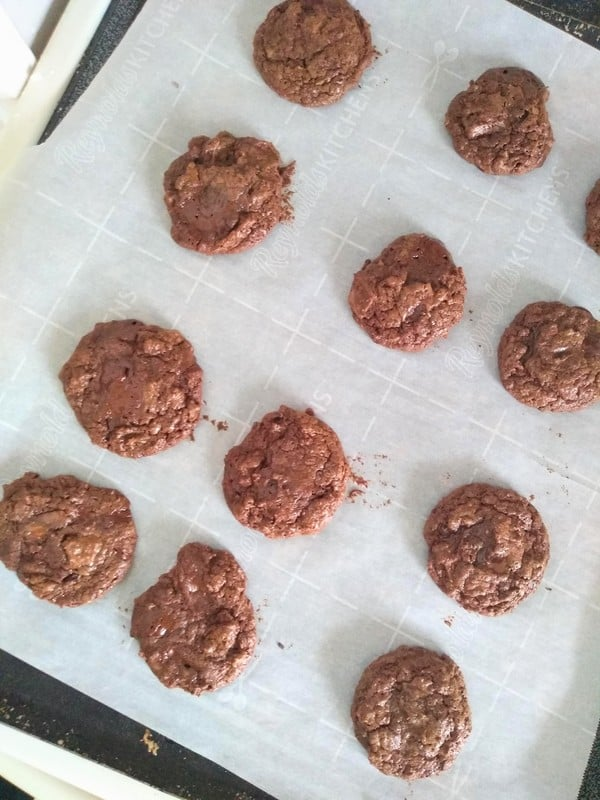 Cookies on a sheet pan lined with parchment paper