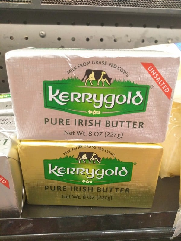 Kerrygold unsalted gray packaged butter on top of the golden packaged salted butter.