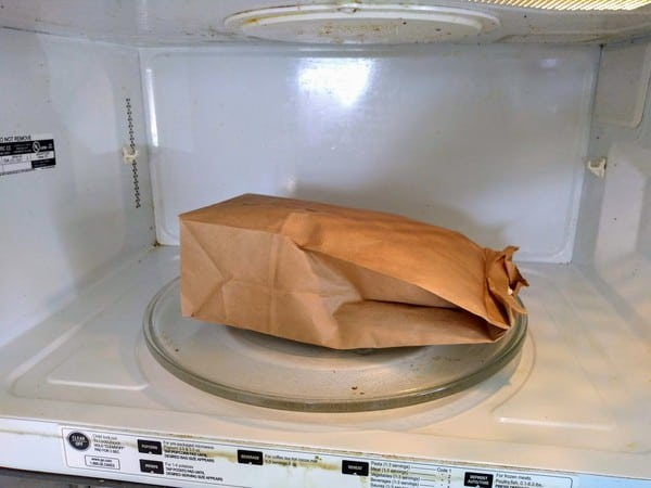 Using a paper bag to make microwave popcorn