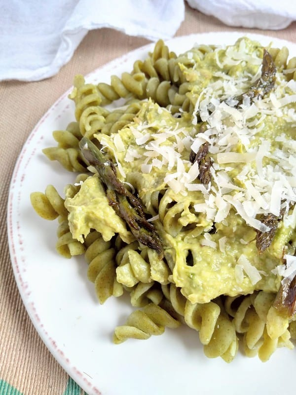 Seaweed rotini pasta topped with asparagus pesto and Parmesan cheese on top