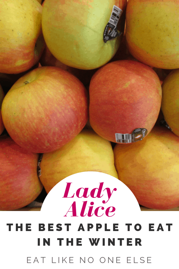 """A display of Lady Alice apples at the store with the words """"Lady Alice the Best apple to eat in the winter"""""""