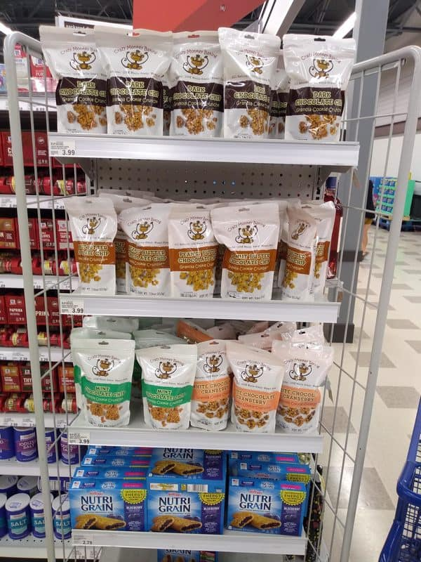 Crazy Monkey Baking Granola Cooke Crunch at a Meijer store. The flavors are Dark Chocolate Chip, Peanut Butter Chocolate Chip, Mint Chocolate Chip, and White Chocolate Cranberry.