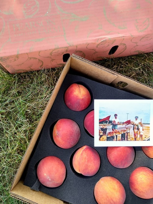 Box of O'Henry peaches sitting on the grass