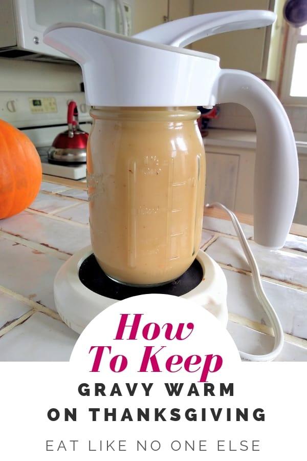 Gravy being kept warm on a coffee mug warmer.