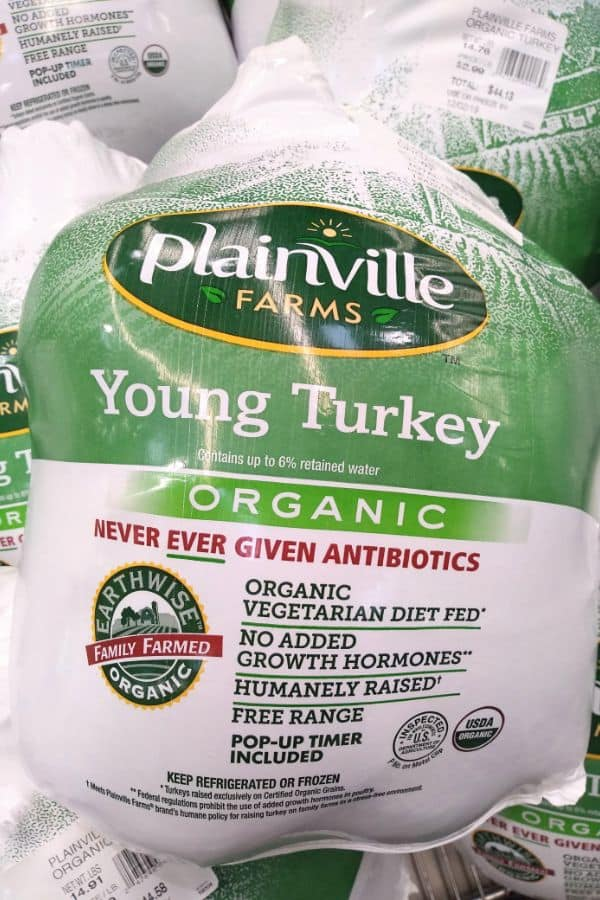 A Planville Farms Young Organic turkey is shown in it's packaging