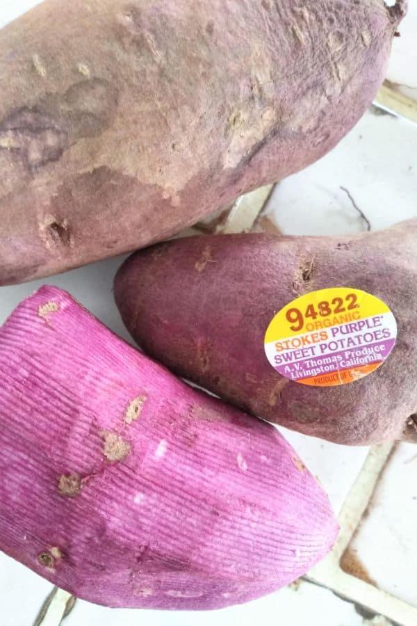 Organic stokes purple sweet potatoes, one peeled