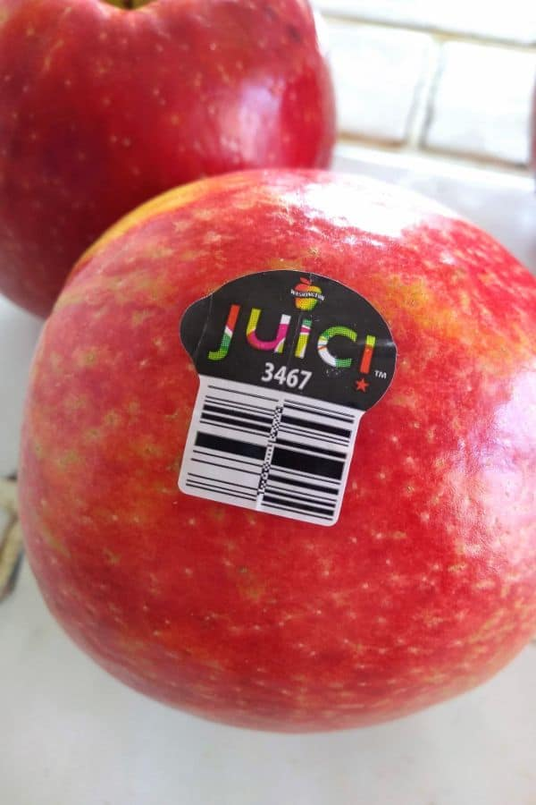 Juici apple with plu sticker showing
