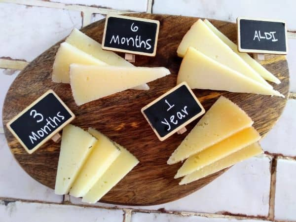 Manchego cheese board with 3 month, 6 month, 1 year, and ALDI cheeses
