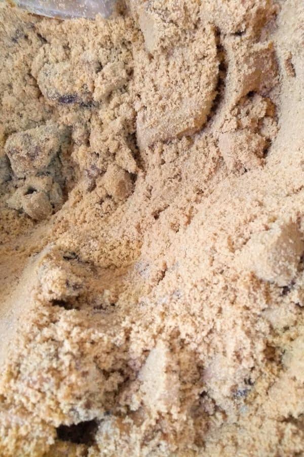 Up close view of Muscovado sugar inside a bin.
