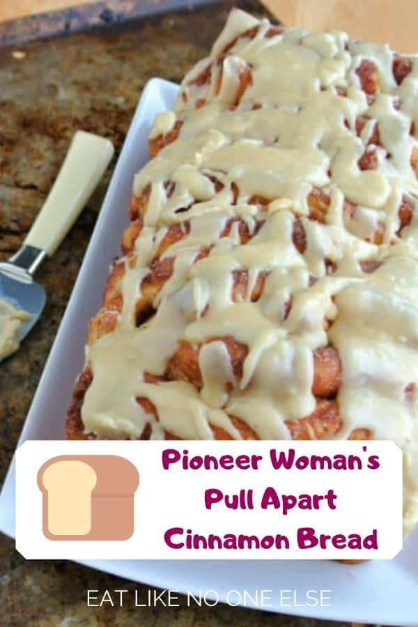 Pioneer Woman's Pull Apart Cinnamon Bread on a plate on top of a sheet pan.