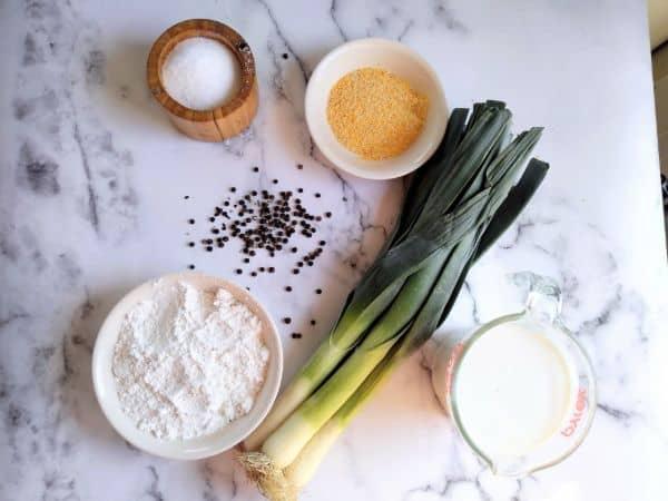 Ingredients for leek rings, leeks, salt, pepper, cornmeal, flour and buttermilk
