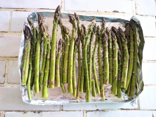 asparagus in a single layer on a homemade foil tray