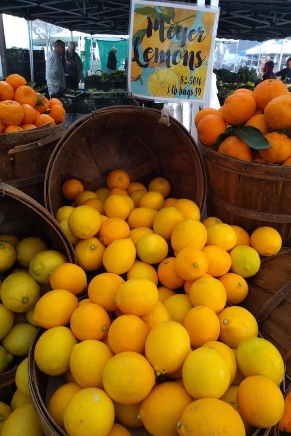 A overflowing basket of Meyer lemons from a farmer's market