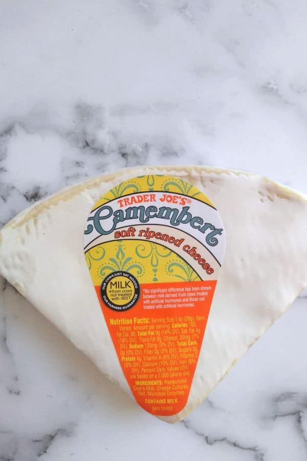 Trader Joe's Brand Camembert cheese is pictured on a counter top
