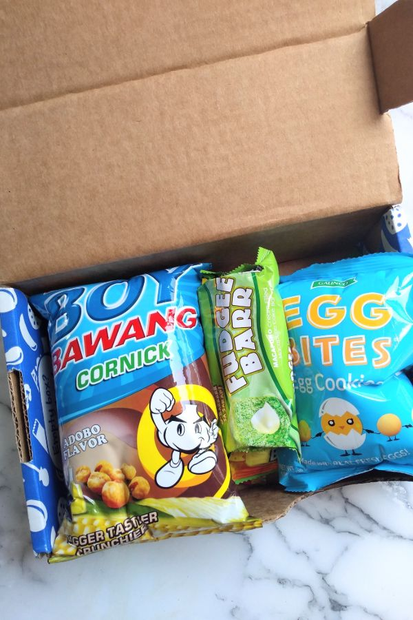 The small size Yum Box of Universal Yums opened with corn nuts, egg cookies, and other snacks