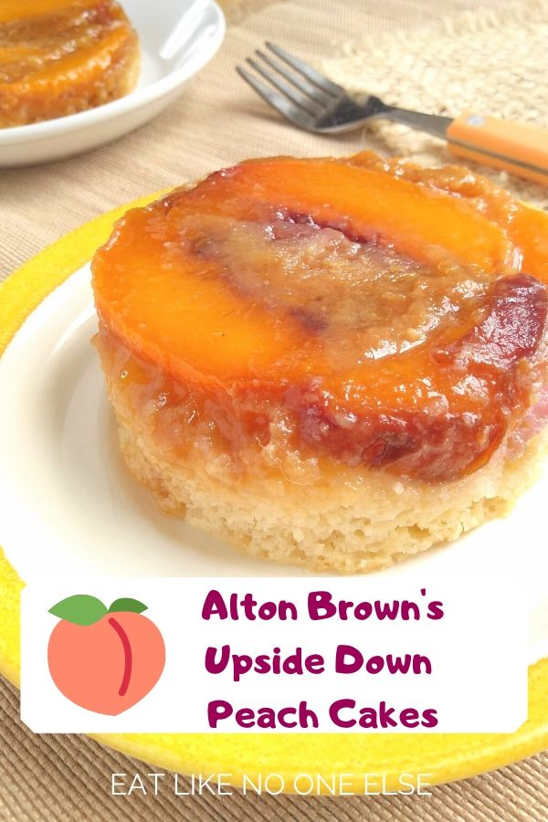 Alton Brown's Upside Down Peach Cakes sitting on a white plate with a yellow border with a fork and a second cake sitting in the background