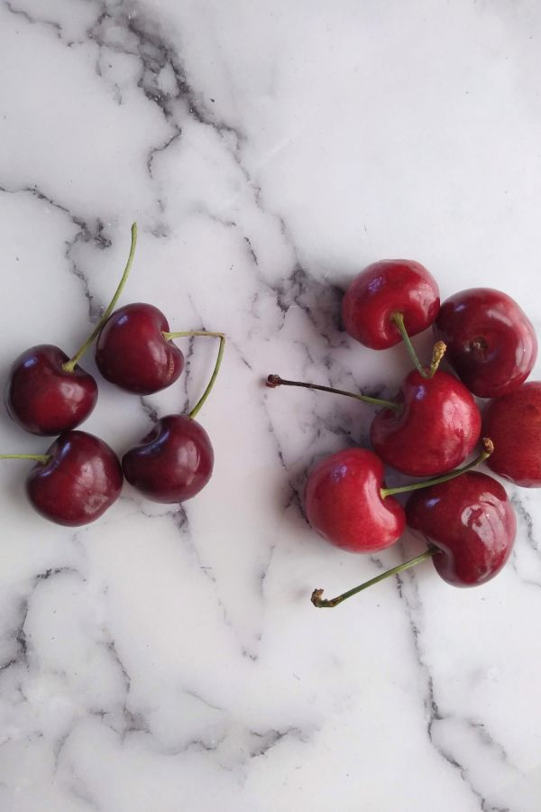 On the left are Bing cherries and on the right are Audra Rose cherries.