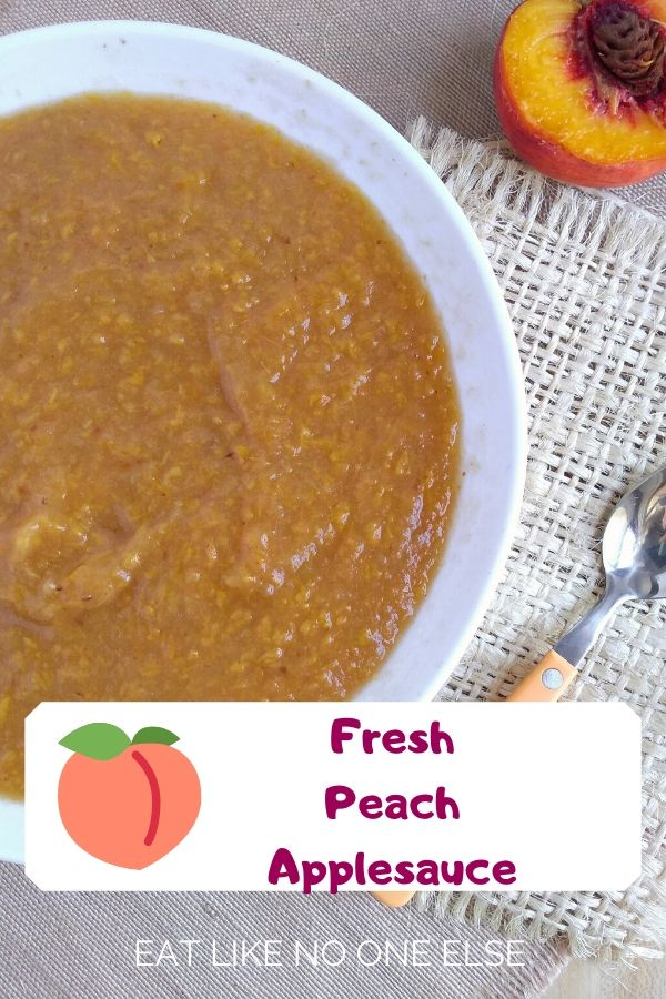 Fresh Peach Applesauce on a burlap cloth and placement with a cut opened peach and spoon nearby