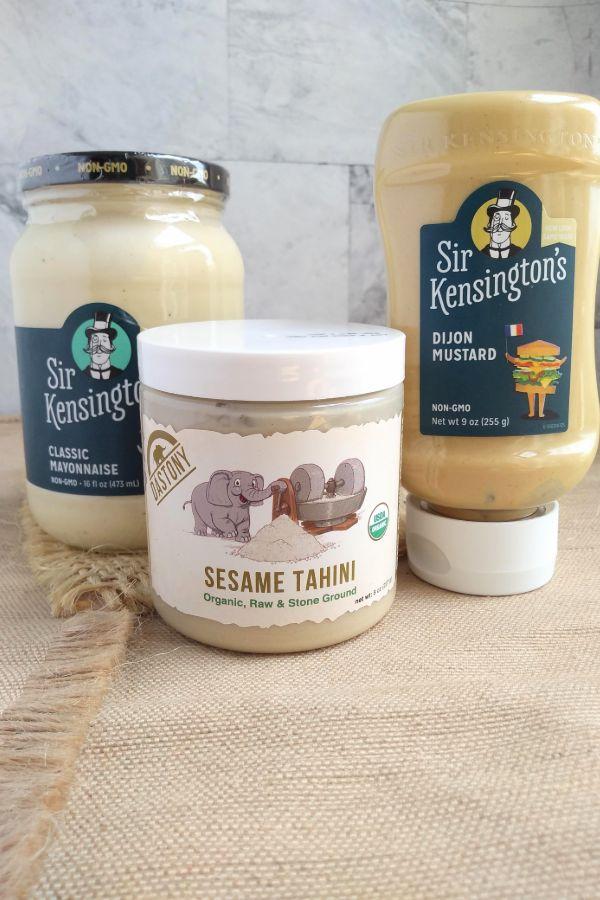 Bottles of Sir Kensington's Classic Mayonaise, Sir Kensington's Dijon Mustard, and Dastony Sesame Tahini
