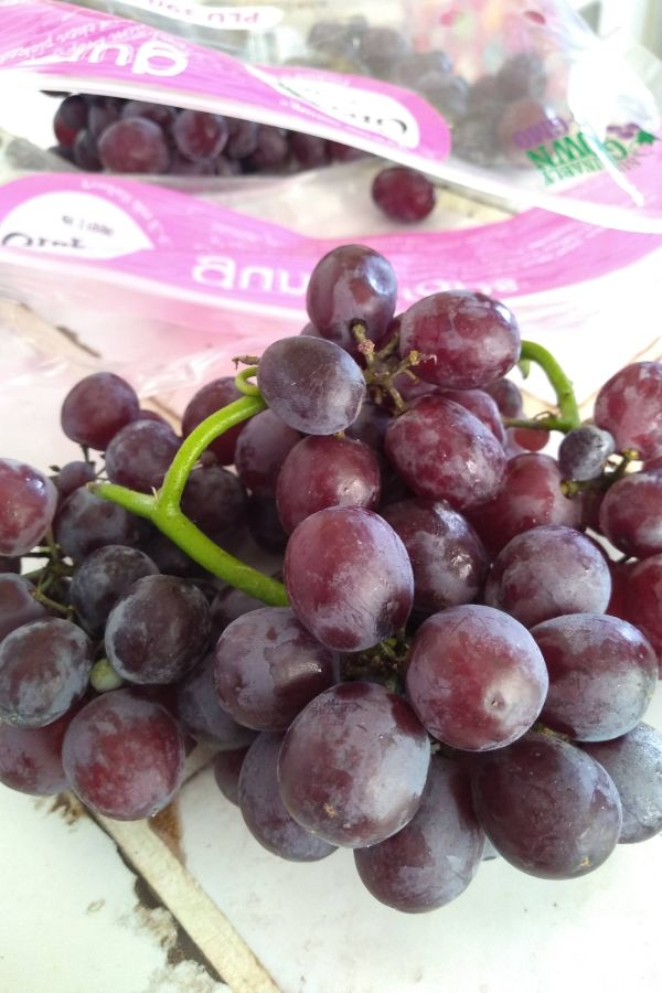 Gum Drops grapes from Grapery spilling out of a bag.