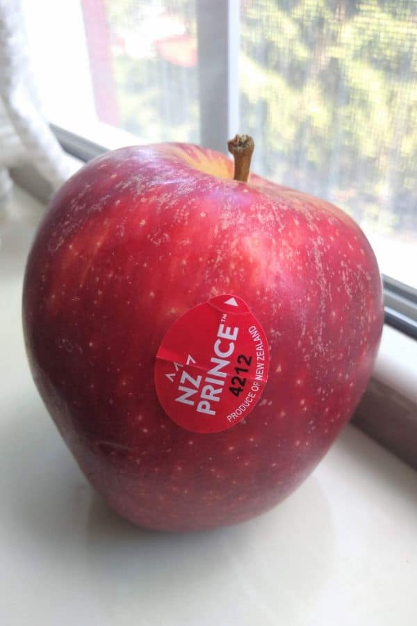 A NZ Prince apple sitting in a window sill