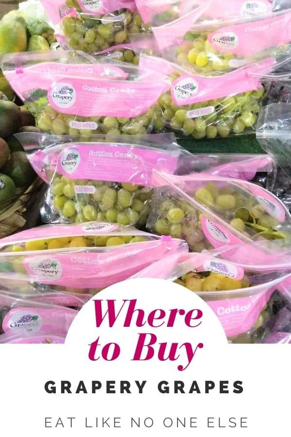 "Bags of Cotton Candy grapes sitting on a store display with the words ""Where to Buy Grapery Grapes"" at the bottom."