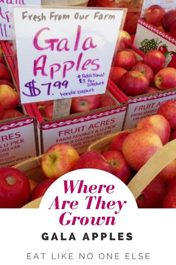 """Boxes of Gala apples with a sign saying Fresh From Our Farm"""" for $7.99 a basket. At the bottom is the words """"Where Are They Grown Gala Apples"""""""