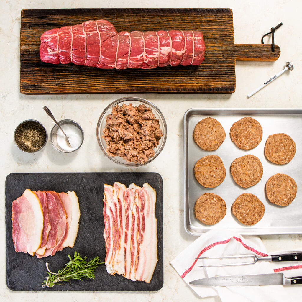 An arrange of beef, sausage, and bacon as a part of a holiday bundle
