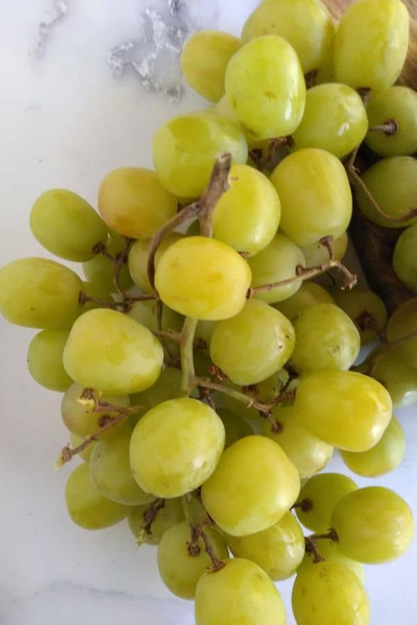 Grapery Green Limited grapes on a white background