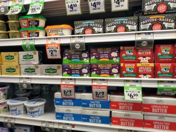 A photo of the dairy section, particularly focused on the butter choices.