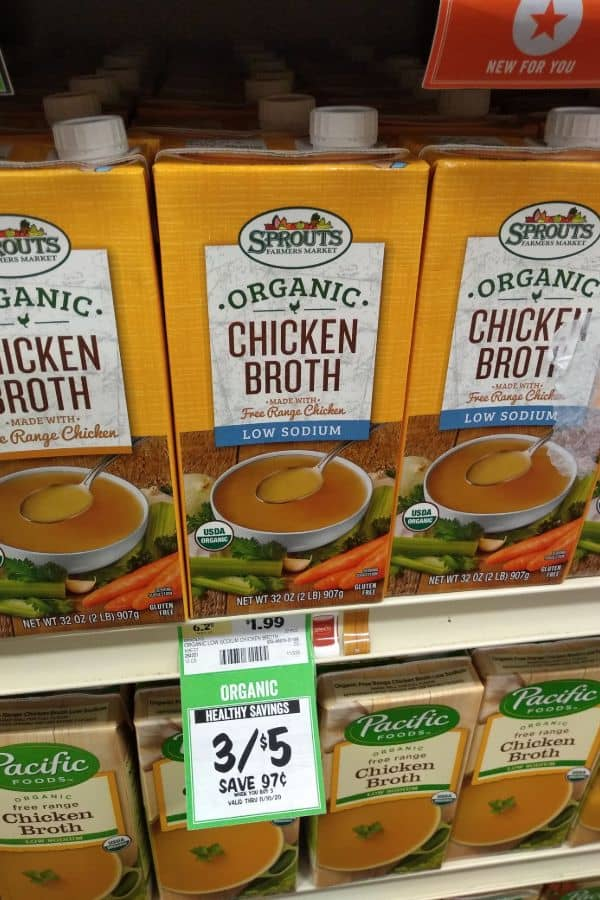 A display of Sprouts Organic Chicken Broth made with Free Range Chicken. The regular and low sodium containers are shown.