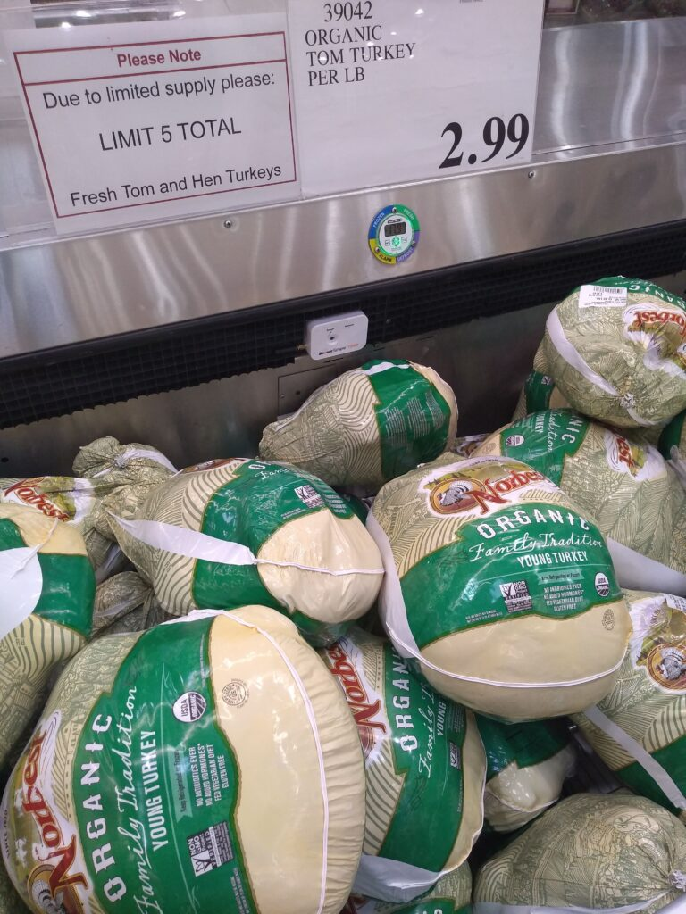 "Organic turkey display at Costco with the words ""due to limited supply please : limit 5 total."