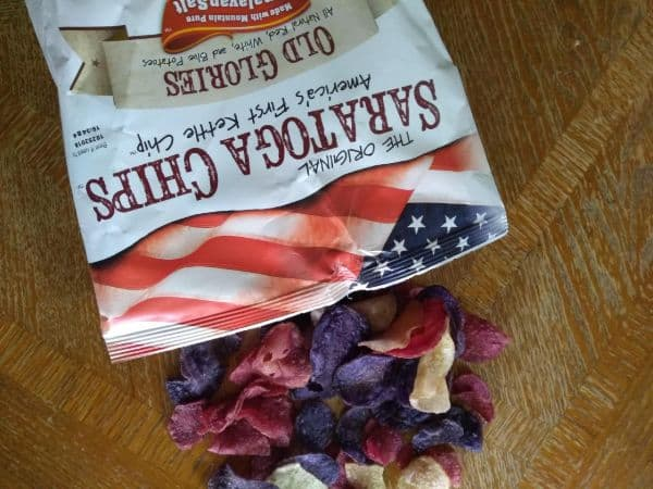 A bag of Saratoga Chips Old Glories spilled out onto a table.