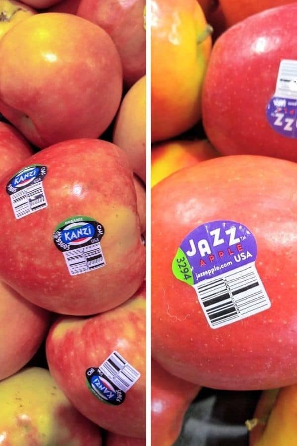 A display of Kanzi apples is pictured next to a display of Jazz apples.