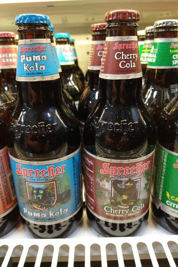 Sprecher Puma Kola next to a bottle of Sprecher Cherry Cola at the grocery store.
