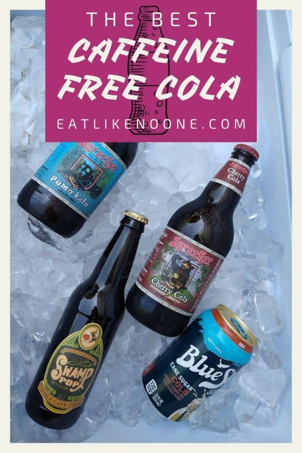 """A cooler filled with ice and caffeine free cola including Sprecher Puma Kola, Sprecher Cherry Cola, Swamp Pop Noble Cane Cola, and Blue Sky Cane Sugar Cola. A box on top says """"The Best Caffeine Free Cola"""""""
