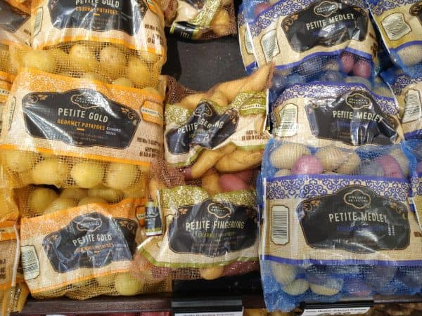 A display at Kroger of Private Selection potatoes featuring left to right, petite gold petite fingerling, and petite medley.