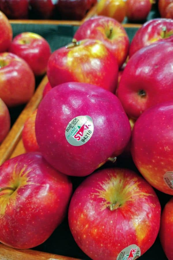 A display of organi Premier star apples stacked up two layers high.
