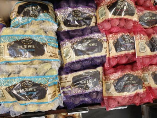 A display of small Private selection potatoes are Kroger featuring Petite White, Petite Purple and Petite Red.